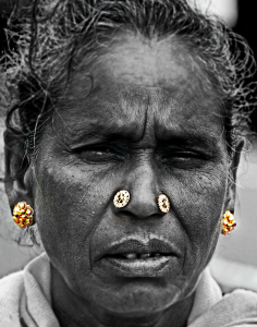 Portrait of an old lady with wrinkled face wearing gold ornaments. Theni, Tamilnadu, India.